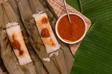 top view of open sticky rice wrapped in leaves and served with peanut sauce. Famous cuisine in Borneo. Brunei, Sarawak and Sabah. Called Kelupis.