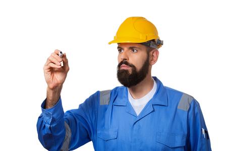 Bearded man builder in helmet with highlighter ready to write something. Bearded man worker with beard in building helmet or hard hat. Portrait architect builder, civil engineer working. Stock fotó
