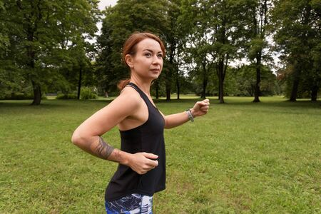 healthy fitness woman running outdoors in the park, vitality lifestyle exercise athlete Stockfoto