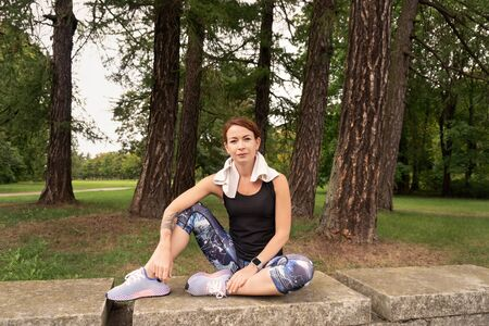 sport woman wearing exercise suit doing stretching yoga fitness exercise in park. Healthy concept. Mind-body improvements concept.