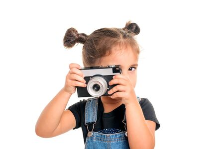 Portrait of cute  baby girl  with vintage camera posing in studio.Isolated