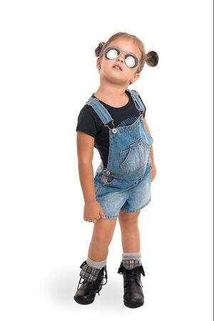 Cute and stilish baby girl  with sunglasses posing in studio.Isolated
