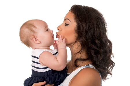 Happy mother with baby girl in profile  isolated Stock Photo