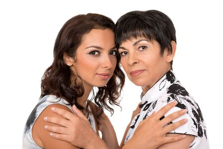 Portrait of happy mother and young daughter on white background.Family relationship, love, affection.