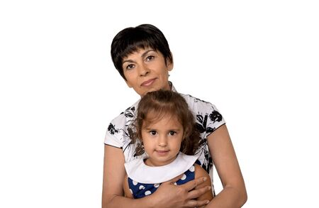 Grandmother with grandchild.Senior woman holding her granddaughter on white background.Family relationship, love, affection.