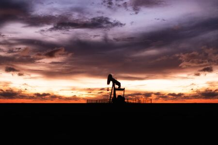 The oil pump, industrial equipment with sunset