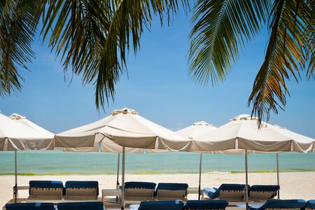 Relax area on beach with umbrellas from sunlight. Holiday, travel,vacation concept