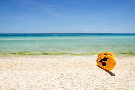 yellow paddle boards and children boats on tropical beach with white sand with copyspace