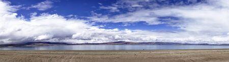 Scenery view Lake Manasarovar with blue sky. Place of prayer, calm and meditation.Tibet,Kailas, China.