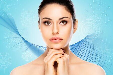 Beautiful woman face portrait on blue technology background