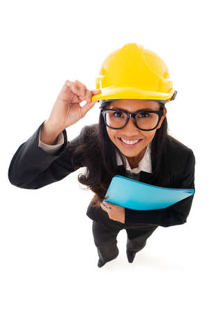 Full length of asian smiling woman architect in eyeglasses holding clipboard. Fun high angle view. Isolated portrait of woman engineer Standard-Bild