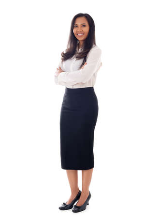 Full length young business woman standing with crossed arms isolated on white background