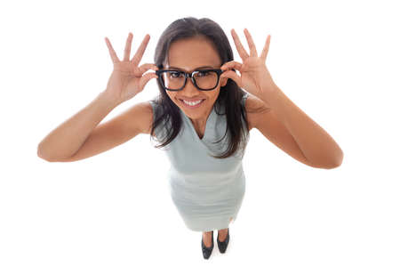 Asian caucasian businesswoman holding her eyeglasses with open palms smiling happy and looking at camera. Dynamic fun high angle view. Isolated on white background in full body. Standard-Bild