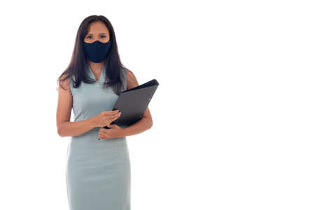 Flu epidemic, dust allergy, protection against virus concept- studio portrait of young asian business woman wearing a face mask, looking at camera, isolated on white background.