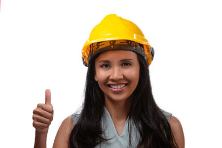 Close up portrait of asian smiling woman architect showing thumbs up gesture, isolated over white background