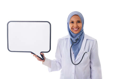 medicine, healthcare, charity and people concept - smiling muslim female doctor wearing blue hijab and white coat with white board and stethoscope over white background