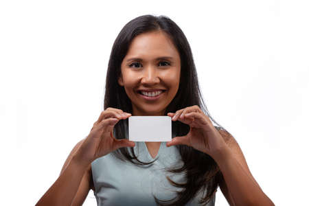 happiness and people concept - close up portrait of smiling asian young businesswoman showing white business or name card isolated over white background Standard-Bild