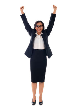 Winner mixed race asian/caucasian woman celebrating success with arms up Isolated on white background