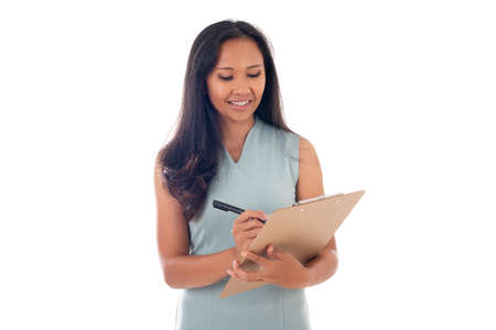 pretty mixed race asian/caucasian woman posing with clipboard isolated over white background