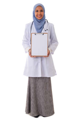 medicine, healthcare, charity and people concept - smiling muslim female doctor/nurse showing empty blank clipboard sign with copy space for text isolated over white background