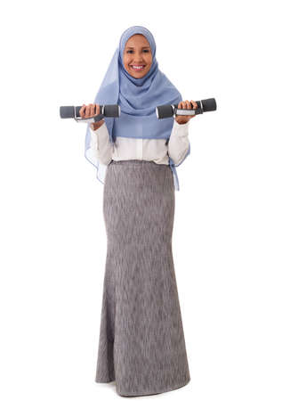 full length of muslim asian womanin casual clothers holding in hands the dumbbells, isolated over white background