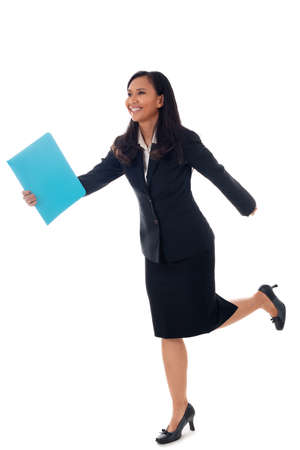 Smiling businesswoman walking with blue folder isolated on white in full body. Mixed-race asian- caucasian brunette female mode