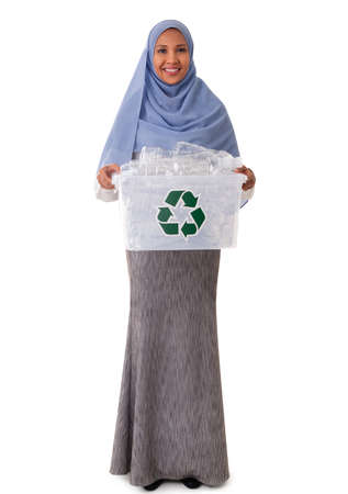 eco living and environment concept - full size of happy smiling asian muslim woman in hijab holding plastic garbage in plastic box isolated over white background