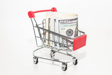 Iron shopping basket with money. Food basket 스톡 콘텐츠