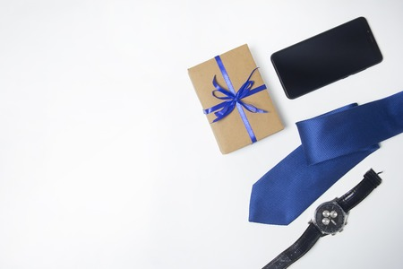 Mens accessories. Watch, tie, phone. Gift for men. Copy space
