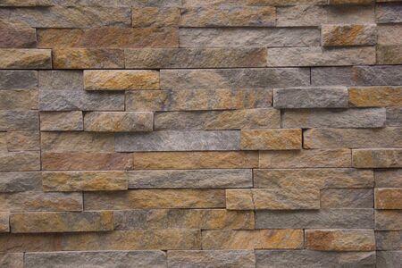 Il nuovo design della parete moderna. Muro di piastrelle di pietra Archivio Fotografico
