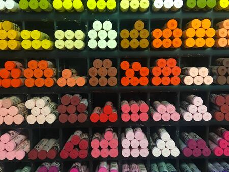 A lot of colorful crayons on a yellow background, Chalk. Assorted Colors Stock Photo
