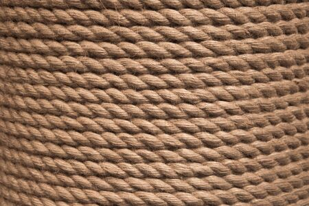 Background twisted rope. Rope background-texture. Brown rope rope texture.