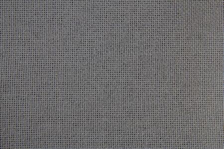 Fabric texture close-up. Grey cloth. Natural fabric.