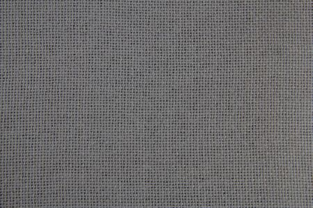 Zbliżenie tekstury tkaniny. Szara tkanina. Tkanina naturalna.