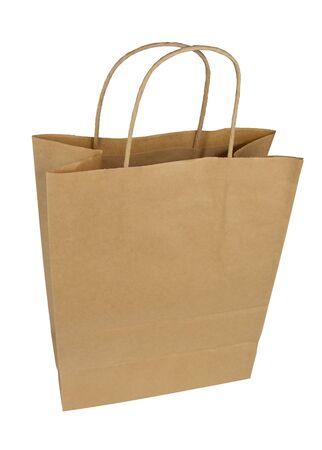 Bolsa de papel sobre un fondo blanco. Aislar el paquete. Bolsa de papel desechable Foto de archivo