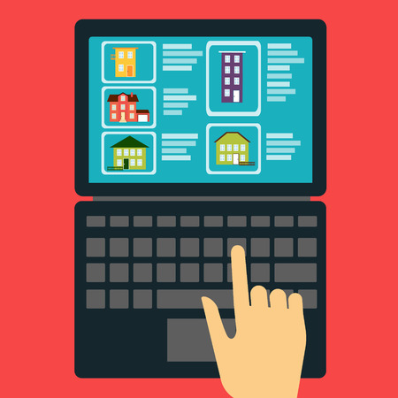 real estate concept. Hand showing on the laptop with a site that sold or rented the houses