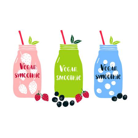 Conjunto de tarro de albañil con las letras vegano batido. Decorado con fresas y arándanos. Concepto de alimentos saludables.