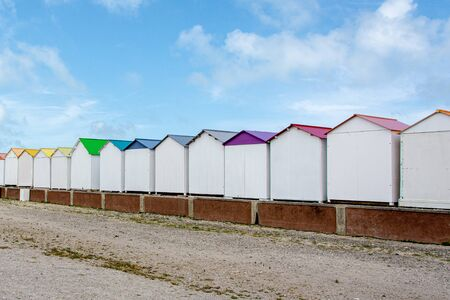 White beach huts with colorful roofs in Criel-sur-Mer, in Normandy - France Stock Photo