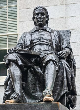 Cambridge, Massachusetts, USA, September 25, 2018. Harvard University, sculpture of John Harvard, in the center of Harvard Yard, the oldest area of the campus.