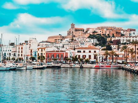 Ibiza, Spain, June 29, 2018.View of the skyline of the old city of Ibiza called Dalt Vila and the port, in turquoise and red tones, on a cloudy day Editorial