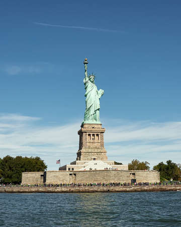 Beautiful view of Liberty Island in New York Bay, where you can see the famous Statue of Liberty, and the Hudson River