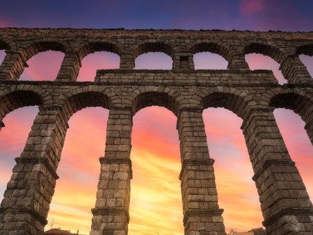 Beautiful red winter sunset at the Roman aqueduct of Segovia, Castilla Leon, Spain, Europe