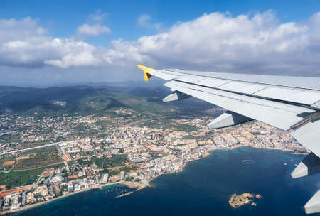 beautiful view from a plane of the Ibiza island, Spain.White airplane wing in flight