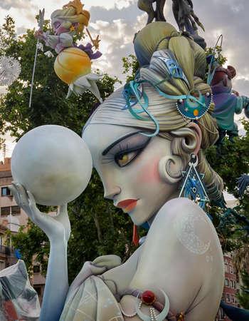 Valencia, Spain, August 31, 2021. Street scene of, Las Fallas de Valencia. Sculpture, fault of the town hall, called the meditator, by, José Ramón Espuig