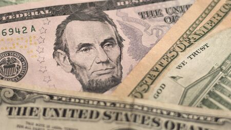 US dollars (USD) currency background with portrait of Abraham Lincoln. Tax planning concept for business, finance, banking, budgeting, economic topics. Banknote background. Selective focus, 16:9 Zdjęcie Seryjne