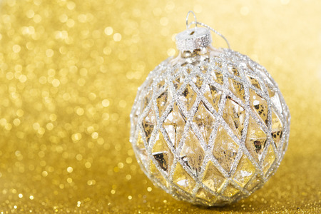 Festive vintage christmas decoration on abstract yellow glitter background photo