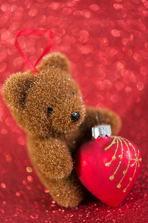 cute bear. christmas decoration on red bright holiday background photo
