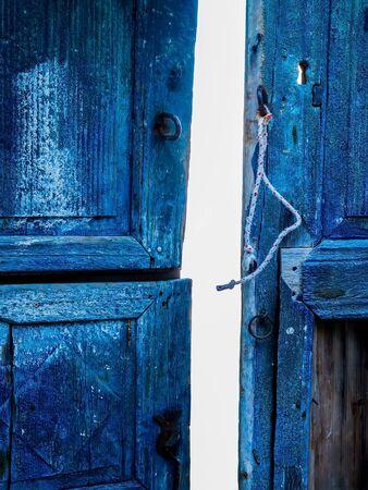 Old blue wooden door texture. Santorini, Cyclades, Greece.