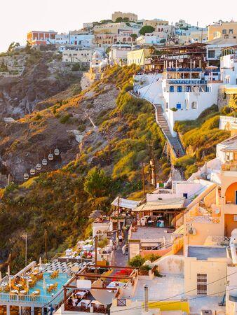 Amazing Santorini view on white cave houses. Santorini, Cyclades, Greece.
