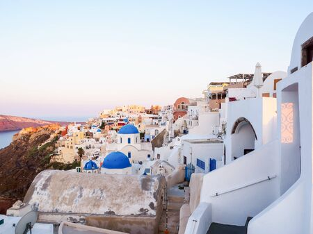 Amazing sunrise Santorini view with cave houses. Santorini island. Cyclades, Greece. Stok Fotoğraf - 148181763